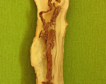 Figurative painting of a saxophone player in solid wood cut