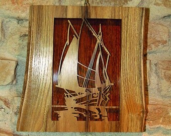 Decorative painting of a sailboat made of solid wood cut