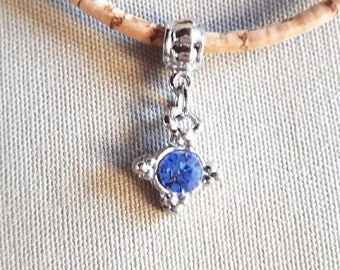 Cork, with a blue rhinestone pendant necklace