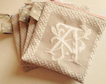 Flat clutch with embossed Monogram
