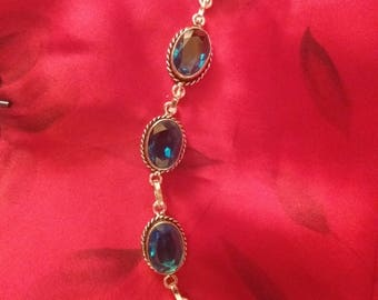 Sterling Silver and Blue Topaz Bracelet 6 1/2 to 7 1/2 inches long