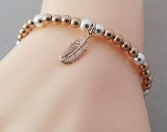 Feather Charm Stacking Bead Bracelet, Rose gold Stretch Bracelet, Rose gold jewelry