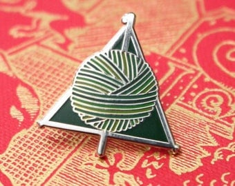 "HALLOWS in ""Cunning"". Crochet knit craft themed enamel pin; by Harbour Crochet. Harry Potter, Deathly Hallows, Slytherin House Colours"