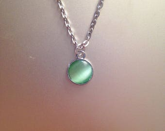 Green cat's eye and silver nickel pendant necklace