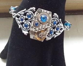 With a watch gear steampunk bracelet