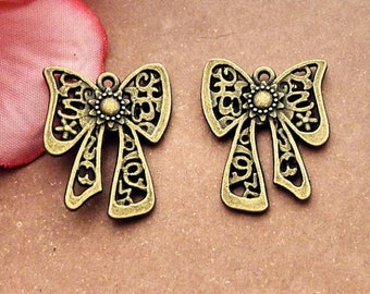 10 bronze bow charms