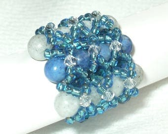 Blue ring with natural pearls
