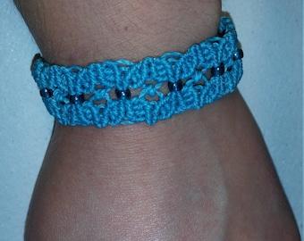 Light blue macrame bracelet with turquoise beads and practical sliding