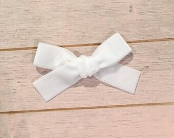 White velvet Hand tied schoolgirl bow for babies, toddlers and little girls on lcip or nylon headband