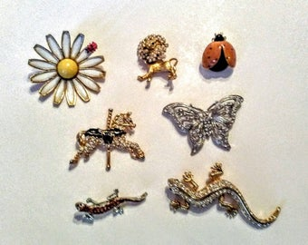 Lot of figural brooches. Weiss Coro Ladybugs, Lion, lizards and more.