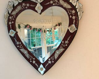 Venetian glass mirror heart shaped with red accents