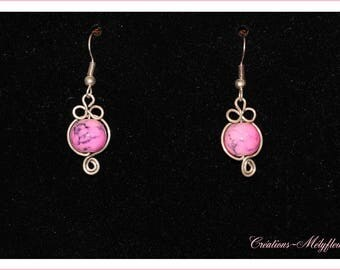 Beautiful earrings with pink pearls
