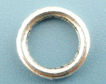 AX3 - set of 24 jump rings closed silver 8mm