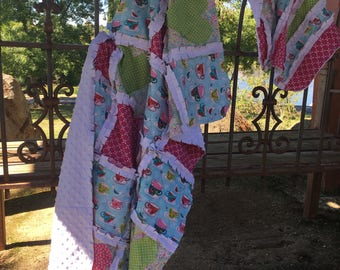 Beautiful Handmade Rag Quilts that can be personalized with color or scheme, superheroes, romantic places or memories.