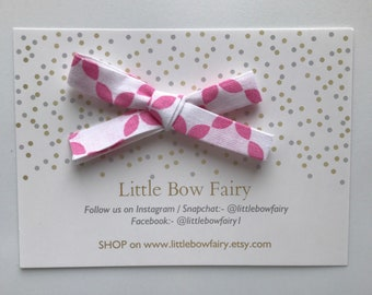 Pink & white floral material bow