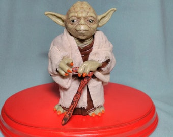 12cms Star Wars Yoda figure. With cane and cloth clothing
