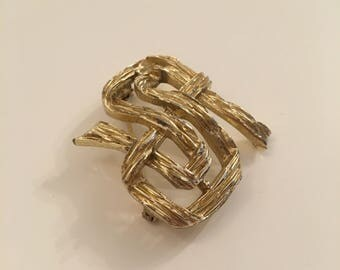 Beautiful vintage gold tone infinity brooch