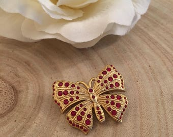 Vintage gold tone butterfly brooch with faux rubies