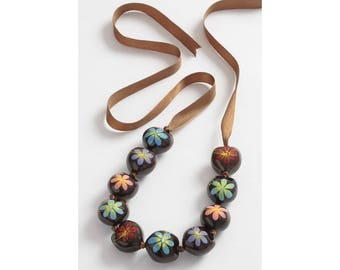Hand painted Kukui beads on a ribbon necklace