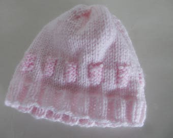 Knitted light pink baby hat