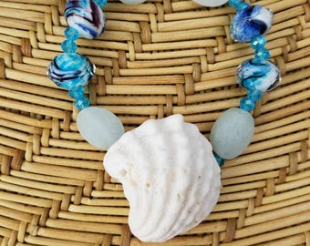Stretch Bracelet made with Beached Shell and Blue Glass Beads