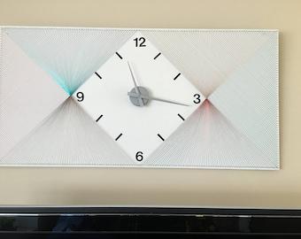 A rare handmade clock in Filografi art