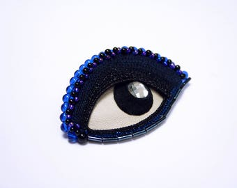 Crocheted and embroidered textile blue eye brooch * Kleo *.