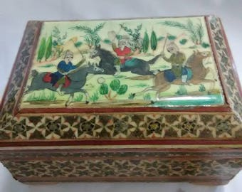 Vintage hand carved and painted wooden box. Has a small wooden house inside.