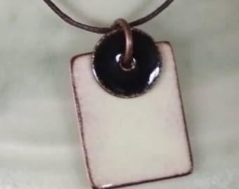 cream enamel pendant