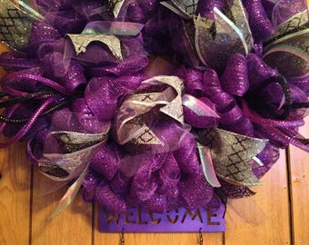 Purple welcome home wreath