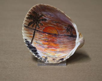 Sunset, palm tree scene painted on a real sea shell.