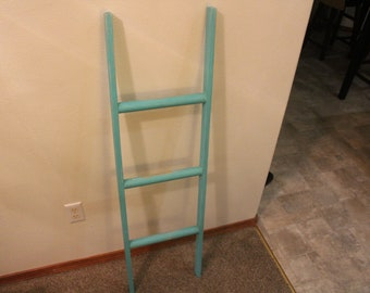 Rustic teal colored ladder