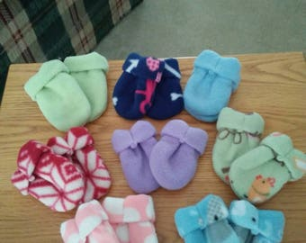 Baby fleece thumbless mittens. Variety of colors. Double layered. Dart on front for snugger fit. Choice of one pair.