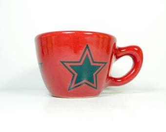 a 12oz cup glazed in Berry Red with Star prints READY to SHIP