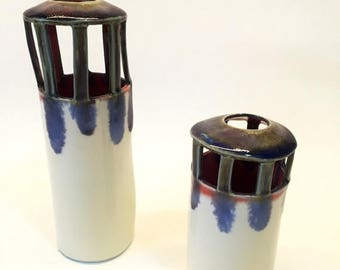 June sale Set of two tower vases made from porcelain.