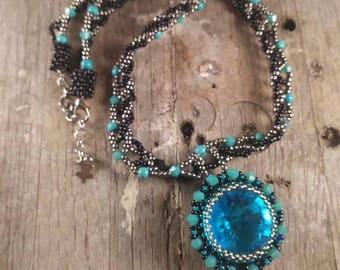 Turquoise beaded necklace with large crystal rivioli