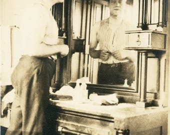 Vintage photo 1919 Reflection Man in Mirror Getting Dressed in Vest