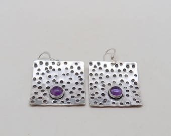 Amethyst earrings set in sterling silver.