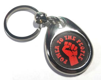 Power to the People Oval Metal Keychain