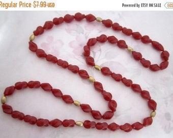ON SALE- vintage plastic carnelian twist bead necklace w hidden clasp - j6159
