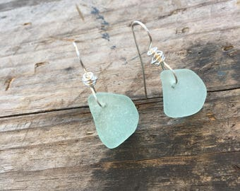 light green sea glass earrings with a sterling silver twist at the top
