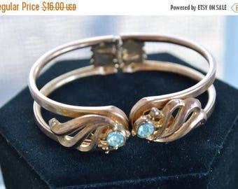 ON SALE Pretty Vintage Light Blue Rhinestone, Gold tone Clamper Bracelet