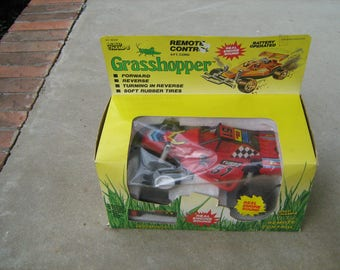 1980s road champs remote control grasshopper  new in the box real engine sound 6' cord forward  and reverse