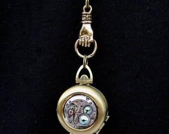 Locket - Steampunk jewelry Antique bronze - Hand holding Double locket green borealis Swarovski crystals - Watch parts - Pendant- Necklace