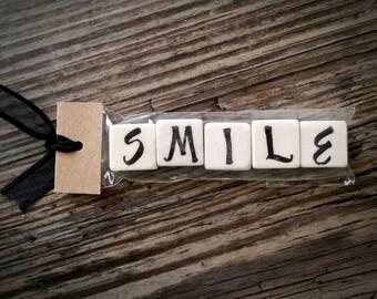 SMILE Tumbled Stone miniMagnet Word Strip