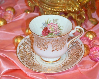 VINTAGE PINK PARAGON teacup and saucer with interior florals
