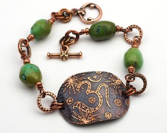 Copper om symbol bracelet, green turquoise beads, etched metal, 7 3/4 inches long