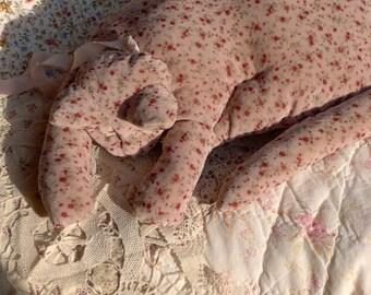 An Antiqued Pink Calico Velvet Cat