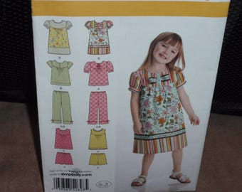 Simplicity 2628 In K Design Dress, Top, Capri Pants and Shorts  Size 3 to 8  New Uncut