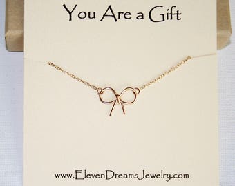 Tiny Bow charm necklace. Gold or silver. Special Message. Meaning. Wire wrap. Dainty